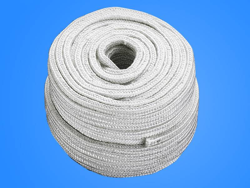 A roll of white square asbestos rope on blue background